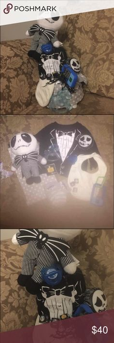 Nightmare before Christmas diaper cake boy Receiving blanket  Stuff jack Bib Teether Pacifier  Socks  Tuxedo shirt Push jack nightlight  Light up toy cell phone 3 nightmare blocks for decor To small for toy  Diapers Will b wrap in plastic with ribbon I also have a Sally one Accessories