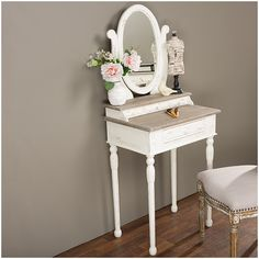 Features: -Traditional French accent dressing table. -Two tier design with dressing mirror. -Four drawers provide functional storage spaces. Style (Old): -Traditional. Finish: -White and light br