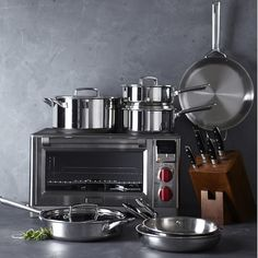 Bring the professional performance and distinctive style of Wolf appliances to your countertop with the Wolf Gourmet electric oven. A striking complement to the iconic Wolf range, this compact cooker is ideal for preparing quick meals, baking, bro… Small Kitchen Appliances, Cool Kitchens, Bottom Freezer Refrigerator, Pots And Pans Sets, Pan Set, Cookware Set, Quick Meals, Cooking Time, Wolf