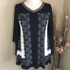 Alfani Woman Black and White Tunic NWT Gorgeous black and white tunic has sheet sleeves and beaded neckline. Asymmetrical hem..Traveler knit fabric drapes wonderfully, super stretchy, and pairs well with leggings or slacks. NWT Alfani Tops Tunics