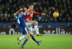 Manchester United's English striker Wayne Rooney vies with Leicester City's English midfielder Danny Drinkwater during the English Premier League...