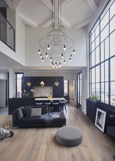 Cuisine ouverte sur le salon - grande hauteur sous plafond - volume lumineux au plein coeur de Paris - Appartement Parisien de 193 m2 - GCG Architectes