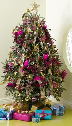 May your days be merry and bright with a Gold Star Tree Topper and assorted ornaments from Pier 1....what pretty colors!!!