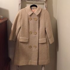 Adorable vintage coat!!!!! Beautiful cream vintage coat. Three-quarter length sleeves, gorgeous buttons and a peter-pan collar. There are no tags on the inside. I am a size 10 and it fits me perfectly. Fabric is a boucle...probably wool but I cannot guarantee. It has recently been dry-cleaned. There is a very minor flaw on the collar..see last picture (hardly noticeable). Vintage Jackets & Coats