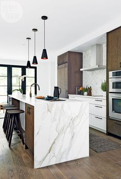 wood cabinets, marble waterfall countertop