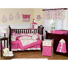 This pink and green themed nine piece baby bedding set was created by JoJo Designs. This set includes a blanket, crib bumper, crib skirt, fitted sheet, toy bag, decorative throw pillow, diaper stacker, and two window valances.