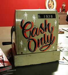 Lettering on an old cash register for 19:28 Tattoo Parlour (Barcelona).