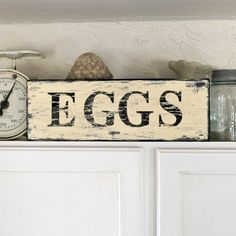 Eggshell background, with black letters & edging, distressed all over.  Love the rustic feel.