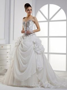 Dramatic Ball Gown Sweetheart Strapless Floor-length Beading Ruched Wedding Dress. I love the top more than the skirt part