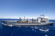 The guided-missile destroyer USS Gravely (DDG 107) transits alongside the Military Sealift Command fleet replenishment oiler USNS Kanawha (T-AO 196) for a replenishment-at-sea.