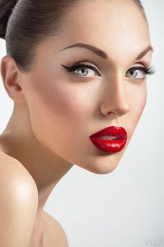 Highly processed and stunning because of it.  Great skin retouching, added red saturation (vibrance?)  and added lashes.