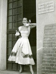 Model in summer dress featuring straw fringe on the skirt by Veneziani, Milan, 1949-50