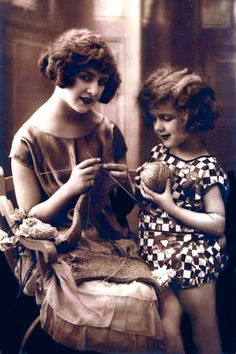 Lots of old knitting images: http://www.agoodyarn.net/Images/KnittingImages/DuotoneWomanChildKnitB.jpg