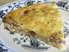 HAM & SWISS CHEESE QUICHE   4 ounces Swiss cheese, grated   1 cup smoked ham, chopped, 5-6 ounces   3 tablespoons onion, chopped, 1 ounce   3 eggs   1 cup heavy cream   1/8 teaspoon pepper    Arrange the cheese, ham and onion in greased pie plate. Beat the eggs, cream and pepper; pour evenly into the pan. Bake 350º 30-35 minutes until a knife inserted in center comes out clean. Let stand 10 minutes before cutting.