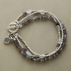 Storm Clouds Bracelet Item No. 58170 $98.00 Storm cloud colors of labradorite, moonstone and amethyst are shot through with the radiance of...