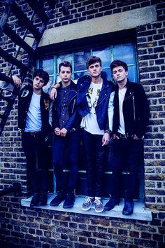 The Vamps casually on a window ledge...