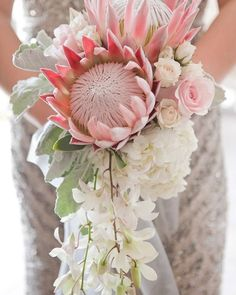 Protea bouquet anyone? Will you make a statement with your bouquet? We adore this one shot by @tanaphotography. @allurebridals @jimmychoo @theiacouture @menwarehouse see the entire feature on the #weddingchicks .com right now! #weddingbouquet #weddingflowers #protea #weddingphotographer via @angela4design