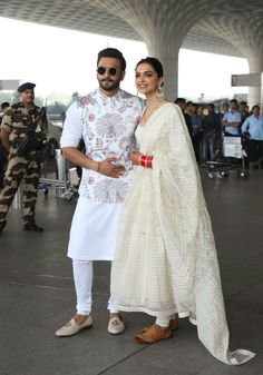 Stunning Airport Looks Newly weds heartthrobs Deepika Padukone and Ranveer Singh scintillate in ethereal white palette as they head out of Mumbai for their first wedding reception - to be held in Bengaluru on November, We heart! Wedding Kurta For Men, Wedding Dresses Men Indian, Wedding Dress Men, Celebrity Wedding Dresses, Wedding Suits, Wedding Sherwani, Indian Dresses, Celebrity Weddings, Bridal Dresses