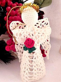 """Lovely white crochet angels for use as ornaments, figurines or Christmas tree topper Handmade stiffened crochet with crochet red rose Metallic gold halo and 2 1/2"""" gold cord hanging loop Approximately 5"""" tall  1 1/2"""" diameter opening will accommodate ..."""