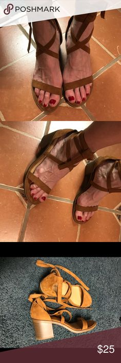 Faux suede caramel colored wrap sandals Caramel colored ankle wrap suede like sandals with two inch heels. Never worn Merona Shoes