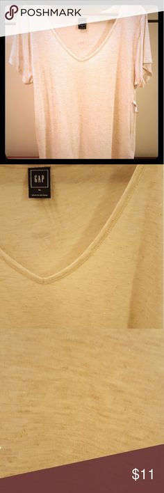 Gap tee shirt Super soft flowy tee from Gap. Light beige color with some shimmer sewn in! Deep V neck. Long enough to wear with leggings. Size XL (would also fit Large). NWT! GAP Tops Tees - Short Sleeve