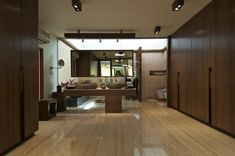 Courtyard House by Hiren Patel Architects - travertine floors, walnut paneling
