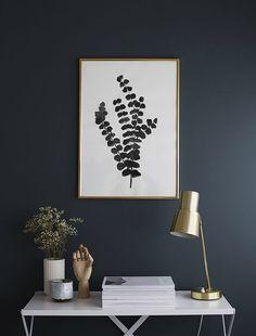 Dark wall + print + metal fixtures