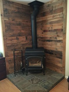 Pallet wall behind wood stove More
