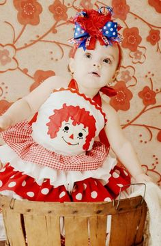 Girls Over the Top Raggedy Ann Boutique Hair Bow with Ostrich Puff Center. $16.99, via Etsy.