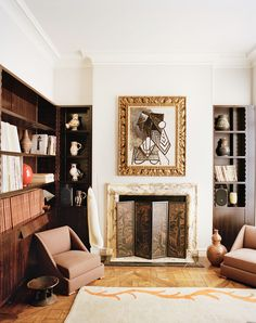 Timeless and elegant home library with fireplace and abstract artwork