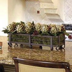 Centerpiece in cabinet cutout. Love this arrangement idea with artichokes. Tuscan decor idea. Love the tile color and layout behind it as well!