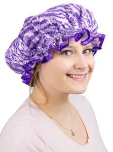 Sequined Zebra Shower Cap by Purpletopia. $12.75. Flashy zebra print fabric with clear sequins. Heavy duty PVC liner keeps hair dry. One size fits most. Coordinating purple satin trim. This purple shower cap is a pretty way to keep your locks dry while you're enjoying that luxurious bubbly soak or shower. The subdued zebra print and flashy sequins make this shower cap a huge step up from the basic opaque versions that are commonly available.