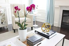 AM Dolce Vita: Spring Refresh - Part Trois, Coffee table styling, Phalaenopsis orchid, West Elm brass sculptural sphere, Coffee table books, black white gold design