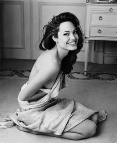Angelina Jolie -- oh she is glamorous and kick butt at the same time -- love LoVe LOVE her