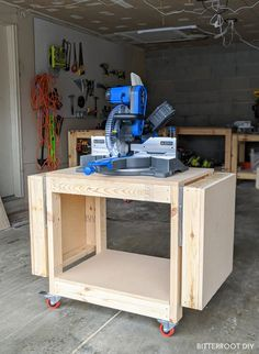 Build this DIY mobile miter saw stand with collapsible wings with free plans from Bitterroot DIY. Build this DIY mobile miter saw stand with collapsible wings with free plans from Bitterroot DIY. Miter Saw Stand Plans, Diy Miter Saw Stand, Miter Saw Table, Mitre Saw Stand, Mitre Saw Bench, Wood Shop Projects, Easy Woodworking Projects, Woodworking Plans, Woodworking Resin