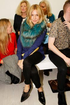 Sienna Miller is a longtime friend and muse of Matthew Williamson - She wore a colourful fur stole with a blue cardigan, black jeans and carried a yellow clutch to attend his spring/summer 2014 fashion show.