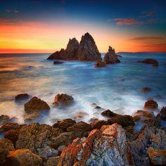 Rocks on the Beach by Noval Nugraha  #landscape #seascape #nature #sky #photography #sea #beach #sunset #shore #rocks #waves #water
