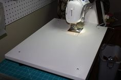 make your own sewing machine extension table - http://christophernejman.blogspot.com/2013/03/make-sewing-machine-extension-table.html