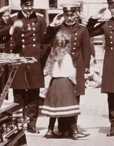 """Grand Duchess Anastasia Nikolaevna Romanova of Russia being greeted by officers on the Imperial Royal yacht,the Standart. """"AL"""""""