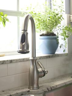 granite on window sill - make sure you have enough room for gooseneck faucet when doing template for counter