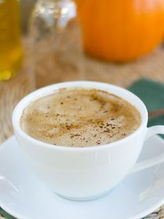 Paleo Pumpkin Spice Coconut Latte includes all the flavors of fall. It's rich, creamy and dairy-free.   cookeatpaleo.com