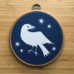 Crow cyanotype on fabric OOAK hoop wall hanging Cyanotype Process, Crow, Hand Stitching, Paper Cutting, My Drawings, Printing On Fabric, I Shop, Cotton Fabric, Wall