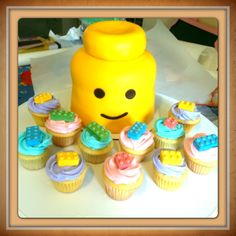 Lego head cake with cupcakes
