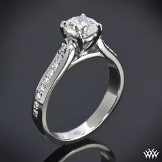 """Whiteflash Signature Design, this """"Cathedral Pave"""" Diamond Engagement Ring is a sight to behold with its 18 sparkling A CUT ABOVE® Hearts and Arrows Diamond Melee (0.20ctw; F/G VS) lining either side of the center stone."""