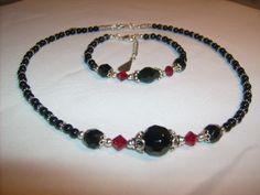 Necklace of Black onyx, Swarovski, glasspearls and silver.