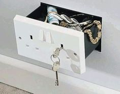 Secret compartment wall safe disguised as electrical wall outlet. I think if I did this, it might look suspicious how many outlets I had. Secret Walls, Secret Rooms, Secret Hiding Places, Hiding Spots, Hidden Compartments, Secret Compartment, Secret Storage, Hidden Storage, Hidden Safe