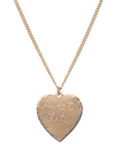 "No, I don't think there's anything odd about wearing a pendant necklace that says ""Sweet Tits"" on it.  I think it's cute.  So what.  Sweet nothings pendant necklaces by In God We Trust, Summerland shop."