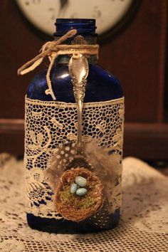 Vintage blue eggs in nest decorated shabby bottle by divinehippie, $15.50