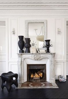 Black accents surround this stunning mantle.
