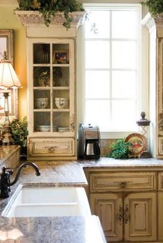good use of farm sink and glazed cabinetry - ...like the trim work